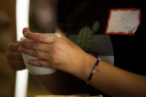Mary Kame Ginoza wears a bracelet adorned with the colors of the asexuality flag during a meetup organized by Asexuality SF in San Francisco on Sunday, July 15, 2018. (Randy Vazquez/ Bay Area News Group)
