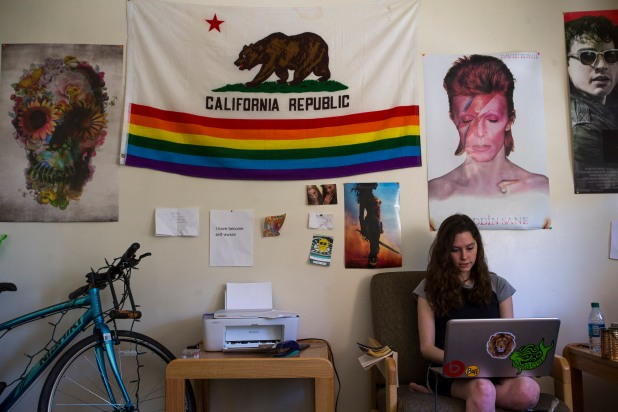 Delaney Van Riper works on her laptop in her apartment on Wednesday, May 9, 2018, in Santa Cruz, Calif. Van Riper, a UC Santa Cruz student, has a degenerative muscle condition called Charcot-Marie-Tooth disease. Van Riper hopes through the use of the gene-editing technology called CRISPR, she can overcome her condition. (Randy Vazquez/ Bay Area News Group)