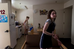 Delaney Van Riper, right, stands in the living room of her apartment while her roommate Hannah Montgomery, left, walks into the kitchen on Wednesday, May 9, 2018, in Santa Cruz, Calif. Van Riper, a UC Santa Cruz student, has a degenerative muscle condition called Charcot-Marie-Tooth disease. Van Riper hopes through the use of the gene-editing technology called CRISPR, she can overcome her condition. (Randy Vazquez/ Bay Area News Group)