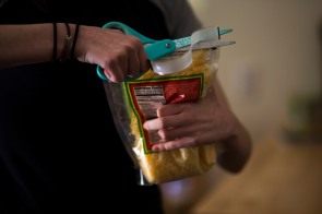 Delaney Van Riper opens a bag of cheese with a pair of scissors on Wednesday, May 9, 2018, in Santa Cruz, Calif. Van Riper, a UC Santa Cruz student, has a degenerative muscle condition called Charcot-Marie-Tooth disease. The conditions makes task such opening bottles or bags of food difficult since she does not have full strength in her hands. Van Riper hopes through the use of the gene-editing technology called CRISPR, she can overcome her condition. (Randy Vazquez/ Bay Area News Group)