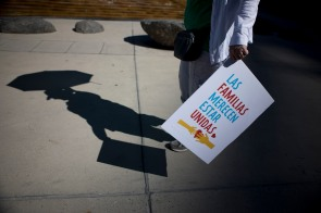 "A shadow of a protester during a ""Families Belong Together"" rally in San Jose, Calif., on Saturday, June 30, 2018. Several rallies were held across the country to protest family separation at the U.S.-Mexico border under President Trump's ""zero tolerance"" policy. (Randy Vazquez/ Bay Area News Group)"