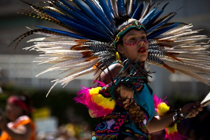 "Members of Movimiento Cosmico perform a dance before a ""Families Belong Together"" rally in San Jose, Calif., on Saturday, June 30, 2018. Several rallies were held across the country to protest family separation at the U.S.-Mexico border under President Trump's ""zero tolerance"" policy. (Randy Vazquez/ Bay Area News Group)"