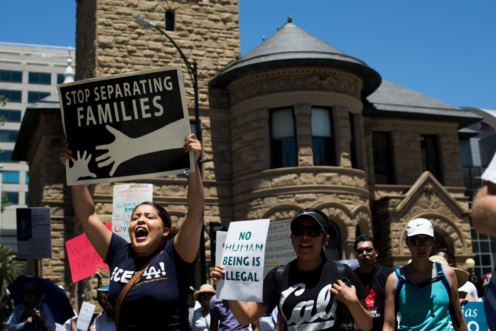 "Monica Cardenas, left, chants during a ""Families Belong Together"" rally in San Jose, Calif., on Saturday, June 30, 2018. Several rallies were held across the country to protest family separation at the U.S.-Mexico border under President Trump's ""zero tolerance"" policy. (Randy Vazquez/ Bay Area News Group)"