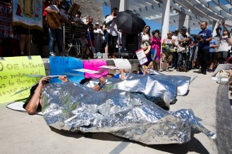 "Members of Grupo la Solidaridad lay blanketed on the ground to represent the many children at U.S. Customs and Border Protection detention centers who sleep under mylar blankets during a ""Families Belong Together"" rally in San Jose, Calif., on Saturday, June 30, 2018. Several rallies were held across the country to protest family separation at the U.S.-Mexico border under President Trump's ""zero tolerance"" policy. (Randy Vazquez/ Bay Area News Group)"