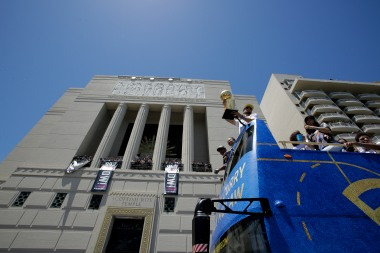 Stephen Curry holds up the NBA Championship trophy during the Golden State Warriors' championship parade in front of the Scottish Rite Temple in Oakland, Calif., on Tuesday, June 12, 2018. The Warriors recently swept the Cleveland Cavaliers in the NBA Finals to win their third championship in four years. (Randy Vazquez/ Bay Area News Group)
