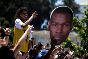 A fan smiles as Kevin Durant passes by during the Golden State Warriors' championship parade in Oakland, Calif., on Tuesday, June 12, 2018. The Warriors recently swept the Cleveland Cavaliers in the NBA Finals to win their third championship in four years. (Randy Vazquez/ Bay Area News Group)