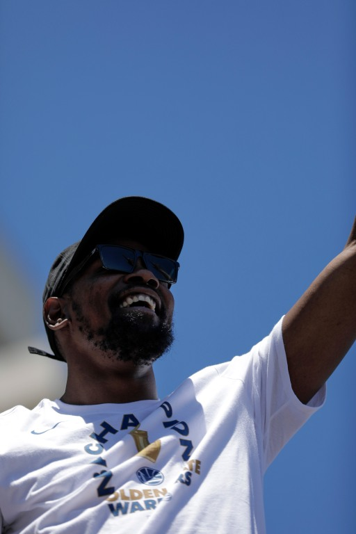 Kevin Durant smiles during the Golden State Warriors' championship parade in Oakland, Calif., on Tuesday, June 12, 2018. The Warriors recently swept the Cleveland Cavaliers in the NBA Finals to win their third championship in four years. (Randy Vazquez/ Bay Area News Group)