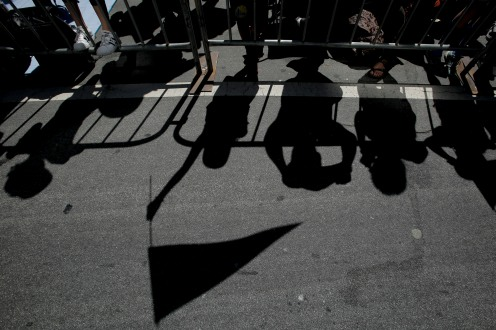 Shadows of fans who wait near Lake Merritt for the Golden State Warriors' championship parade in Oakland, Calif., on Tuesday, June 12, 2018. The Warriors recently swept the Cleveland Cavaliers in the NBA Finals to win their third championship in four years. (Randy Vazquez/ Bay Area News Group)
