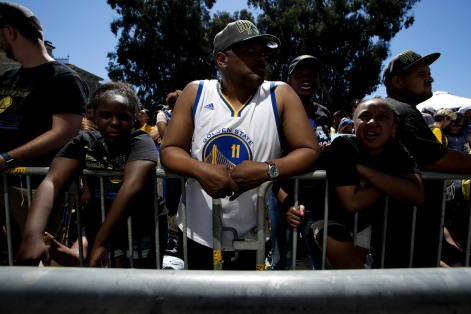Sa'Tavia Qualls, left, Kelvin Alexander, center, and Amariyana Blair, right, wait near Laker Merritt for the Golden State Warriors' championship parade in Oakland, Calif., on Tuesday, June 12, 2018. The Warriors recently swept the Cleveland Cavaliers in the NBA Finals to win their third championship in four years. (Randy Vazquez/ Bay Area News Group)