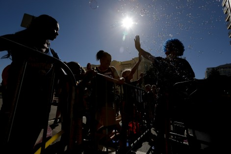 Fans kill time before the the Golden State Warriors' championship parade with a bubble machine in Oakland, Calif., on Tuesday, June 12, 2018. The Warriors recently swept the Cleveland Cavaliers in the NBA Finals to win their third championship in four years. (Randy Vazquez/ Bay Area News Group)