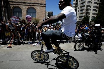 A man rides a scraper bike during the Golden State Warriors' championship parade in Oakland, Calif., on Tuesday, June 12, 2018. The Warriors recently swept the Cleveland Cavaliers in the NBA Finals to win their third championship in four years. (Randy Vazquez/ Bay Area News Group)