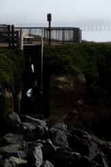 Karl Somerville, bottom, and Erik Simonson, top, go down stairs to reach the ocean to surf in Santa Cruz, Calif., on Thursday, June 21, 2018. A bill to make surfing the official sport of California is finding little resistance as it heads for a state Senate hearing. (Randy Vazquez/ Bay Area News Group)