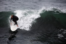 A man surfs near Lighthouse Point n Santa Cruz, Calif., on Thursday, June 21, 2018. A bill to make surfing the official sport of California is finding little resistance as it heads for a state Senate hearing. (Randy Vazquez/ Bay Area News Group)