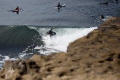 People surf near Lighthouse Point in Santa Cruz, Calif., on Thursday, June 21, 2018. A bill to make surfing the official sport of California is finding little resistance as it heads for a state Senate hearing. (Randy Vazquez/ Bay Area News Group)