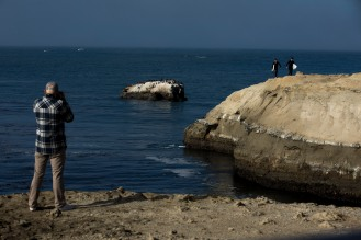 Karl Somerville and Erik Simonson, right, walk on a cliff near Lighthouse Point in Santa Cruz, Calif., on Thursday, June 21, 2018. A bill to make surfing the official sport of California is finding little resistance as it heads for a state Senate hearing. (Randy Vazquez/ Bay Area News Group)