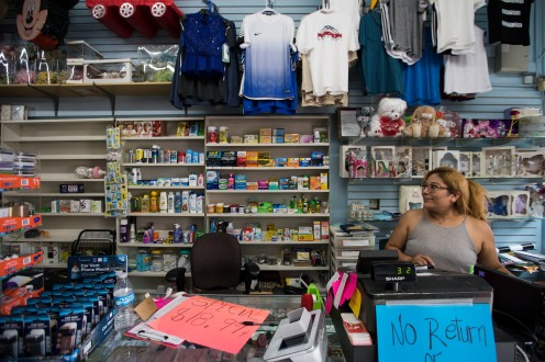 Business owner Hilsi Valdez, right, sits behind the counter of her shop Hilsi's Novedades on Calle Willow in San Jose, Calif., on Tuesday, Aug. 14, 2018. (Randy Vazquez/ Bay Area News Group)