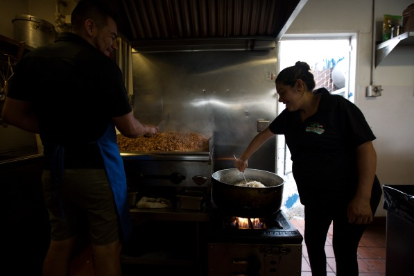 Facundo Segura, left, and his sister Reyna, right, prepare food for their food trucks at Tacos Los 3 Hermanos on Calle Willow in San Jose, Calif., on Tuesday, Aug. 14, 2018. Facundo and Reyna's mother Maria Ceron began the family owned business eight years ago on Calle Willow with one food truck and has since expanded her fleet to four. (Randy Vazquez/ Bay Area News Group)