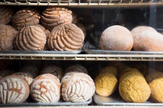 Fresh bread sits behind the display glass at Rico Pan Bakery on Calle Willow in San Jose, Calif., on Tuesday, Aug. 14, 2018. (Randy Vazquez/ Bay Area News Group)