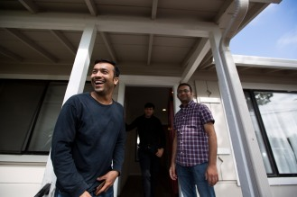 Muhammad Shakeel Naqvi, left, Shaid Muhammad, center, and Muhammad Umair Siddique, right, stand in front of their home in Menlo Park, Calif., on Tuesday, July 17, 2018. The trio rent rooms at the home from their employer Zareen Khan, owner of Zareen's Restaurant. Khan offers below-market rent to four of her key, full time employees. It's a unique way for a small business to keep its employees. (Randy Vazquez/ Bay Area News Group)