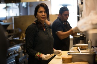 Zareen Khan helps out in the kitchen of her restaurant in Palo Alto, Calif., on Tuesday, July 17, 2018. Khan, owner of Zareen's Restaurant, offers below-market rent to four of her key, full time employees. It's a unique way for a small business to keep its employees. (Randy Vazquez/ Bay Area News Group)