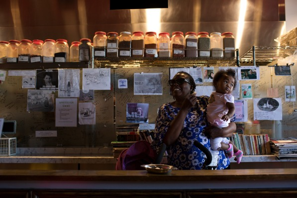 Rachel Reese carries her granddaughter Maajida Davis, 1, at Zareen's Restaurant in Palo Alto, Calif., on Tuesday, July 17, 2018. Zareen Khan, the owner of the establishment, offers below-market rent to four of her key, full time employees. It's a unique way for a small business to keep its employees. (Randy Vazquez/ Bay Area News Group)