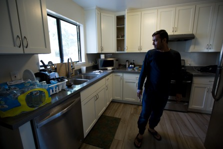 Muhammad Shakeel Naqvi looks out the window in the kitchen of his home in Menlo Park, Calif., on Tuesday, July 17, 2018. Naqvi rents a room from his employer Zareen Khan, owner of Zareen's Restaurant. Khan offers below-market rent to four of her key, full time employees. It's a unique way for a small business to keep its employees. (Randy Vazquez/ Bay Area News Group)
