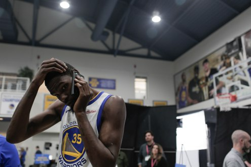 Kevin Durant takes a phone call during Golden State Warriors Media Day in Oakland, Calif., on Monday, Sep. 24, 2018. (Randy Vazquez/Bay Area News Group)