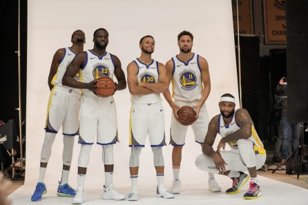 From left, Kevin Duran, Draymond Green, Stephen Curry, Klay Thompson, and DeMarcus Cousins take a photo together during Golden State Warriors Media Day in Oakland, Calif., on Monday, Sep. 24, 2018. (Randy Vazquez/Bay Area News Group)