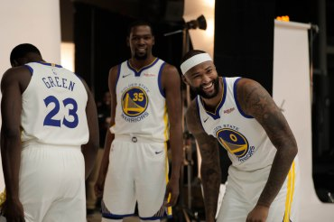 DeMarcus Cousins, right, smiles while talking to teammates, Kevin Durant, center, and Draymond Green, left, during Golden State Warriors Media Day in Oakland, Calif., on Monday, Sep. 24, 2018. (Randy Vazquez/Bay Area News Group)