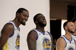 Kevin Durant, left, Draymond Gree, center, and Stephen Curry, right, laugh while taking a photo during Golden State Warriors Media Day in Oakland, Calif., on Monday, Sep. 24, 2018. (Randy Vazquez/Bay Area News Group)
