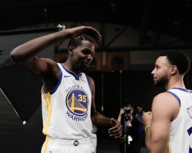 Kevin Durant, left, talks to Stephen Curry, right, during Golden State Warriors Media Day in Oakland, Calif., on Monday, Sep. 24, 2018. (Randy Vazquez/Bay Area News Group)