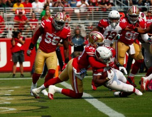 Arizona Cardinals' David Johnson (31), right, scores a touchdown while being tackled by San Francisco 49ers' Adrian Colbert (27), left, in the second quarter of their game at Levi's Stadium in Santa Clara, Calif., on Sunday, Oct. 7, 2018.(Randy Vazquez/Bay Area News Group)