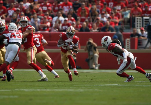 San Francisco 49ers' Matt Breida (22) runs through a hole in the first quarter of his teams' game versus the Arizona Cardinals at Levi's Stadium in Santa Clara, Calif., on Sunday, Oct. 7, 2018.(Randy Vazquez/Bay Area News Group)