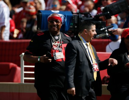 Rapper E-40 smiles before the game between the San Francisco 49ers and the Arizona Cardinals at Levi's Stadium in Santa Clara, Calif., on Sunday, Oct. 7, 2018.(Randy Vazquez/Bay Area News Group)