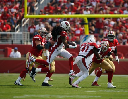 Arizona Cardinals' Bene Benwikere (23), center, intercepts a ball in the first quarter of his teams game versus the San Francisco 49ers at Levi's Stadium in Santa Clara, Calif., on Sunday, Oct. 7, 2018.(Randy Vazquez/Bay Area News Group)