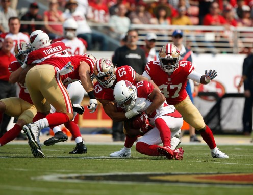 San Francisco 49ers' Mark Nzeocha (53), center, tackles Arizona Cardinals' Christian Kirk (13) in the second quarter of their game at Levi's Stadium in Santa Clara, Calif., on Sunday, Oct. 7, 2018.(Randy Vazquez/Bay Area News Group)
