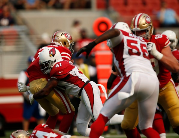 San Francisco 49ers starting quarterback C.J. Beathard (3), left, gets hit by Arizona Cardinals' Antoine Bethea (41), center, in the second quarter of their game at Levi's Stadium in Santa Clara, Calif., on Sunday, Oct. 7, 2018.(Randy Vazquez/Bay Area News Group)