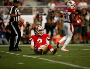 San Francisco 49ers starting quarterback C.J. Beathard (3) sits on the grass after getting hit by Arizona Cardinals' Antoine Bethea (41) in the second quarter of their game at Levi's Stadium in Santa Clara, Calif., on Sunday, Oct. 7, 2018.(Randy Vazquez/Bay Area News Group)