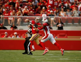 San Francisco 49ers starting quarterback C.J. Beathard (3), left, throws a pass out of bounds after being pressured by Arizona Cardinals' Josh Bynes (57), right, in the second quarter of their game at Levi's Stadium in Santa Clara, Calif., on Sunday, Oct. 7, 2018.(Randy Vazquez/Bay Area News Group)