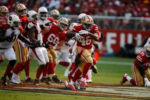 San Francisco 49ers' Alfred Morris (46), pulls an Arizona Cardinals defender in the third quarter of their game at Levi's Stadium in Santa Clara, Calif., on Sunday, Oct. 7, 2018.(Randy Vazquez/Bay Area News Group)