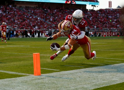 San Francisco 49ers' Kyle Juszczyk (44) stretches for the end zone while being tackled by Arizona Cardinals' Bene Benwikere (23) in the fourth quarter of their game at Levi's Stadium in Santa Clara, Calif., on Sunday, Oct. 7, 2018.(Randy Vazquez/Bay Area News Group)