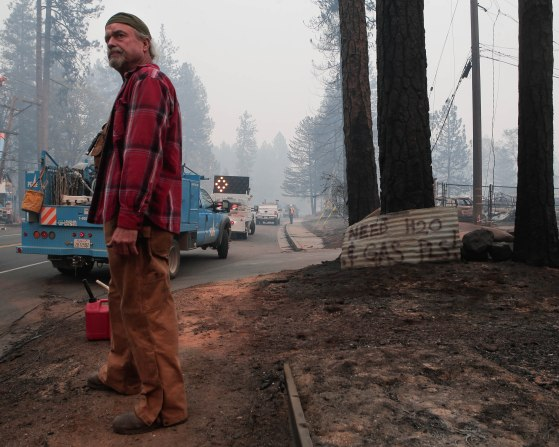 Brad Weldon stands near the intersection of Skyway and Lisa Lane asking for gas and water in Paradise, Calif., on Saturday, Nov. 10, 2018. Weldon stayed back and fought off the deadly Camp Fire. (Randy Vazquez/Bay Area News Group)