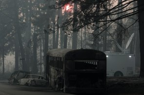 A bus that was burned during the Camp Fire is photographed on the side of Skyway in Paradise, Calif., on Saturday, Nov. 10, 2018. (Randy Vazquez/Bay Area News Group)