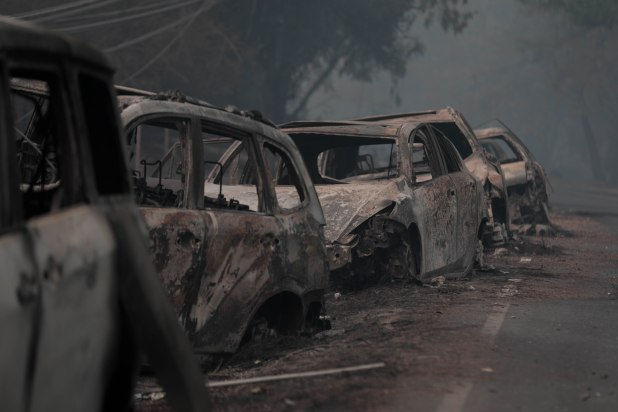 Abandoned cars that were burned during the Camp Fire are photographed on Skyway in Paradise, Calif., on Saturday, Nov. 10, 2018. (Randy Vazquez/Bay Area News Group)