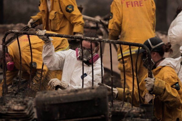 Archeologist with the Human Identification Laboratory sort through fire rubble to try and find victims of the Camp Fire in Paradise, Calif., on Sunday, Nov. 11, 2018. (Randy Vazquez/Bay Area News Group)