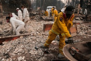 Jessica Curry, right, a grad student with the Human Identification Laboratory sorts threw fire rubble to try and find victims of the Camp Fire in Paradise, Calif., on Sunday, Nov. 11, 2018. (Randy Vazquez/Bay Area News Group)