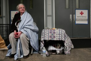 Elaine Smith, left, sits next to her dog Panda, right, outside of a shelter at the Butte County Fairgrounds in Gridley, Calif., on Friday, Nov. 9, 2018. Many evacuees of the deadly Camp Fire came to the shelter. (Randy Vazquez/Bay Area News Group)