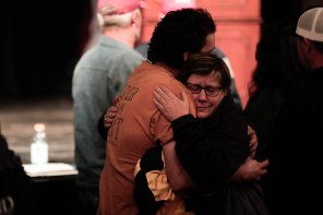 Craig Wilcox, left, hugs Elaina McReynolds, right, after a community meeting at the Laxson Auditorium on the Chico State campus on Saturday, Nov. 10, 2018. Wilcox is from Concow, Calif., and says his house burned down during the Camp Fire. (Randy Vazquez/Bay Area News Group)