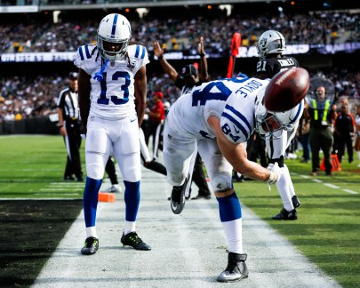 Indianapolis Colts' Jack Doyle (84), right, spikes the ball while celebrating with teammate T.Y. Hilton (13), left, after scoring a touchdown in the fourth quarter of their NFL game versus the Oakland Raiders at the Coliseum in Oakland, Calif., on Sunday, Oct. 28, 2018. (Randy Vazquez/Bay Area News Group)