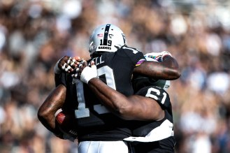 Oakland Raiders' Brandon LaFell (19), left, celebrates with teammate Rodney Hudson (61), right, in the third quarter of their NFL game versus the Indianapolis Colts at the Coliseum in Oakland, Calif., on Sunday, Oct. 28, 2018. (Randy Vazquez/Bay Area News Group)
